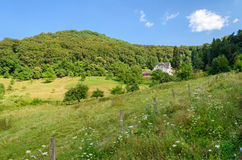 Germany summer country landscape with meadow, forest and a house, background Royalty Free Stock Image