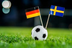 Germany - Sweden, Group F, Saturday, 23. June, Football, World Cup, Russia 2018, National Flags on green grass, white football bal. L on ground stock photos