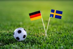 Germany - Sweden, Group F, Saturday, 23. June, Football, World Cup, Russia 2018, National Flags on green grass, white football bal. L on ground stock images