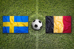 germany sweden vs Belgien flaggor på fotbollfält Royaltyfri Foto