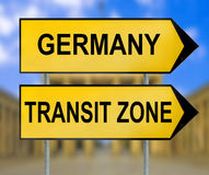 Germany and Transit zone traffic sign with blurred Berlin background Stock Images
