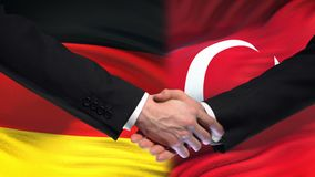 Germany and Turkey handshake, international friendship relations flag background. Stock footage stock video footage