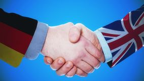 Germany - United Kingdom / Handshake concept animation about countries and politics / With matte channel. Handshaking of the men wearing flag pattern suit 4K stock video footage