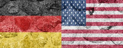 Germany and USA Flag on a stone walBelgium. Germany and USA Flag on a stone wall royalty free stock images