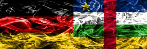 Germany vs Central African Republic smoke flags placed side by s. Ide. German and Central African Republic flag together stock photos