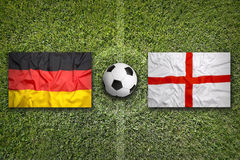 Germany vs. England flags on soccer field Stock Photos