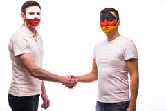 Germany vs Poland friendly handshake egual game on white background. Royalty Free Stock Images