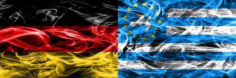 Germany vs South Cameroon smoke flags placed side by side. German and South Cameroon flag together stock photography