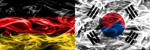 Germany vs South Korea smoke flags placed side by side. German a royalty free stock photo