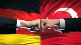 Germany vs Turkey conflict, international relations, fists on flag background. Stock footage stock footage