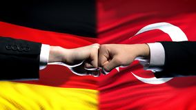 Germany vs Turkey conflict, international relations, fists on flag background. Stock photo stock photo