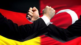 Germany vs Turkey confrontation countries disagreement, fists on flag background. Stock photo royalty free stock photography