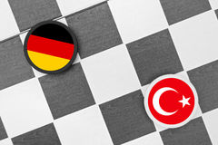 Germany vs Turkey. Draughts (Checkers) - European Union vs Turkey. Conflict between states (refugee crisis, free speech issue, membership in EU royalty free stock photo