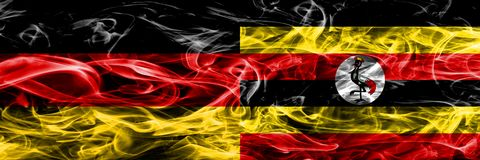 Germany vs Uganda smoke flags placed side by side. German and Uganda flag together royalty free illustration