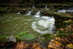 Waterfall pool in forest water stream autumn royalty free stock photo