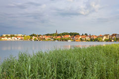 Germany,Western Pomerania,Malchow,View of field and lake Stock Photography