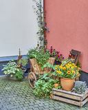 Germany, wooden wagon full of flowers Stock Photos