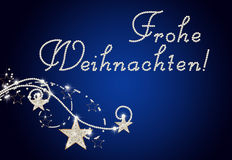Germanys text Frohe Weihnachten. Brilliant curls with germanys text Frohe Weihnachten Stock Photography