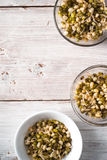 Germinated beans in glass and ceramic bowls on the right Stock Photography