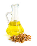 Germinated grains oil in a glass jug. Royalty Free Stock Photo