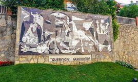 Gernika, Bizkaia,Spain; 2018-04-16: Mural on wall in the city of Gernika that imitating the famous painting of Picasso that bears. His name historic natural royalty free stock photos