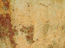 Geroeste oude de verf gele backround van de metaaltextuur stock afbeeldingen