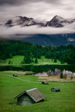 Geroldsee during rainy day with foggy clouds over mountain peaks, Bavarian Alps, Bavaria, Germany. Geroldsee lake during rainy day with foggy clouds over Royalty Free Stock Images