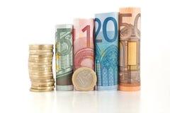 Gerollte Eurorechnungen und Münze Lizenzfreies Stockbild
