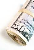 Gerolltes mit einem Band versehenes Pack fünfzig Dollarschein-amerikanisches Geld-Bargeld Stockbild