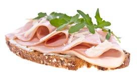 Gerookt ham op brood dat op wit wordt geïsoleerd0 Stock Afbeelding