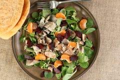 Gerookte makreelbieten en oroange salade Stock Afbeeldingen