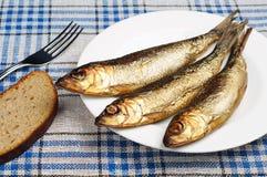 Gerookt vissen en brood Stock Afbeelding
