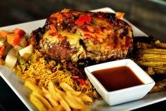 Geroosterd bbq lapje vlees met rozemarijn Stock Foto