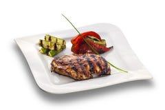 Geroosterd kippenlapje vlees en geroosterde groenten Royalty-vrije Stock Afbeeldingen