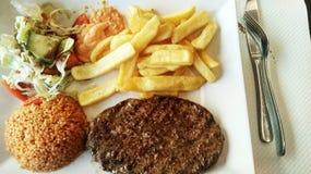 Geroosterd lapje vlees met gebraden gerechten Royalty-vrije Stock Afbeelding