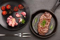 Geroosterd Ribeye-lapje vleesentrecôte op pan Stock Foto's