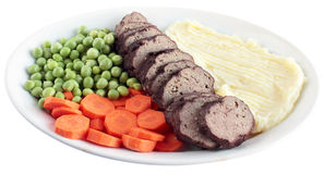 Geroosterd vlees met fijngestampte aardappels en groenten Stock Afbeelding