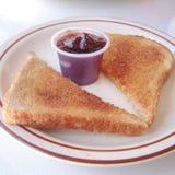 Geroosterde brood en jam stock afbeeldingen