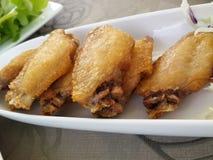 Geroosterde en gebraden kip Stock Foto's