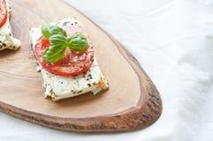 Geroosterde feta met tomaten royalty-vrije stock fotografie