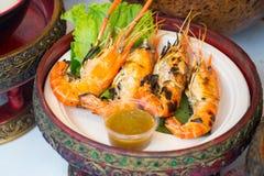 Geroosterde Garnalen en brandwond met zeevruchtensausen, Thais voedsel stock afbeelding