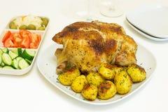 Geroosterde kip en aardappels Stock Fotografie