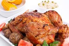 Geroosterde kip met aardappels Royalty-vrije Stock Foto's