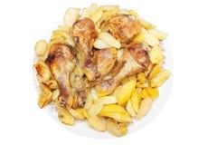 Geroosterde kippenbenen met aardappels stock afbeeldingen