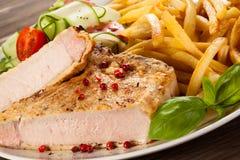 Geroosterde lapje vlees en Frieten Stock Foto