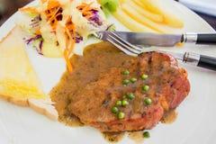 Geroosterde lapje vleesham op witte schotel, het lapje vlees van Dallas Stock Foto's