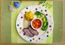Geroosterde varkensvleesribben en vegetarische maaltijd Stock Foto