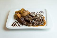 Geroosterde Vleesmedaillons van rundvlees Stock Foto's