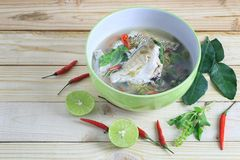 Gerres oyena or Common silver-biddy fish of hot and sour soup on. Wooden floor and have copy space to design in your work Stock Photo