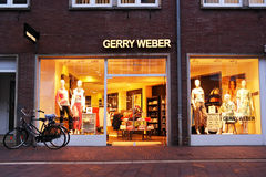 Gerry Weber fashion store in the afternoon. MEPPEN, GERMANY - MARCH 2016: Gerry Weber International AG is a fashion manufacturer and retailer, and manages 1,000 Stock Photography